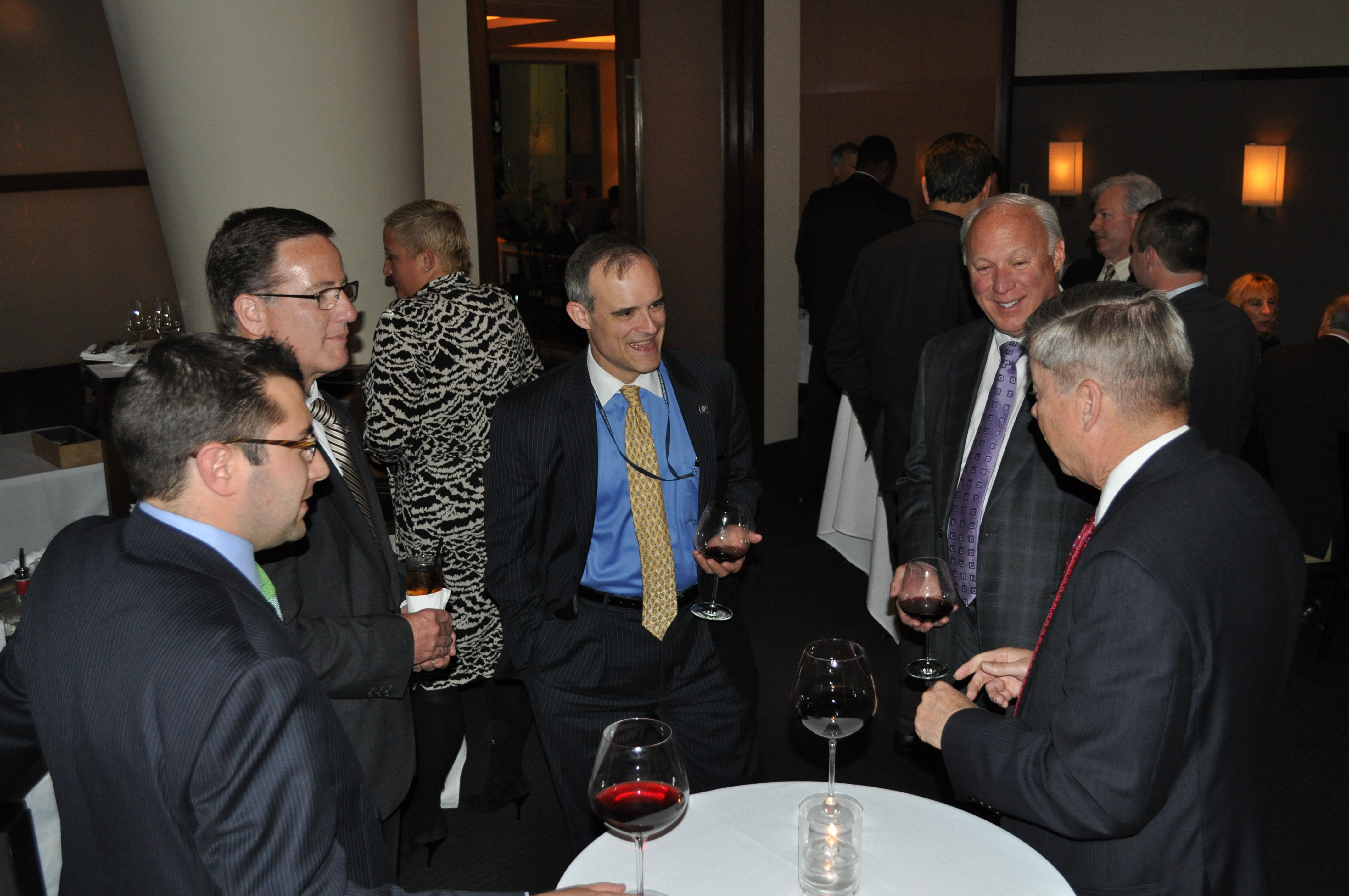 Then White House Cybersecurity Coordinator Michael Daniel (center) shared a light moment with the board before dinner in 2013.
